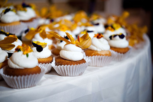 wedding cupcakes with orange orchids