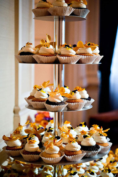 wedding cupcakes with orange flowers