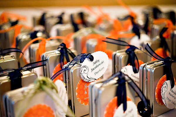 wedding favors with orange and navy blue ribbon