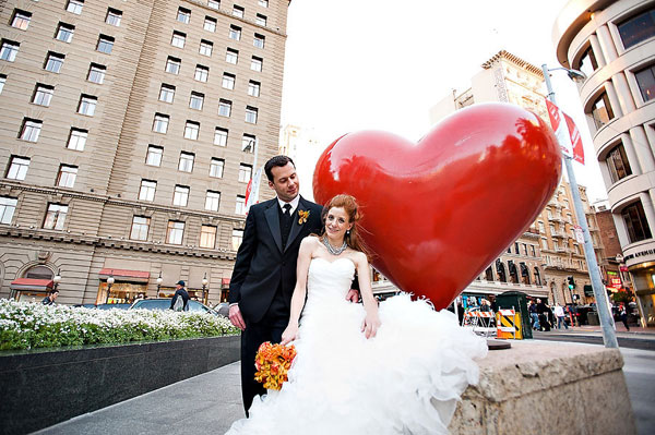 bride and groom with giant heart