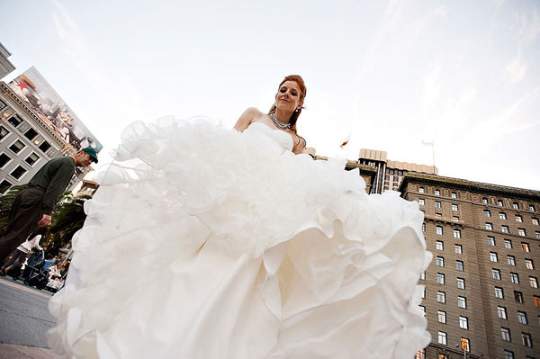 bride's ruffled enzoani wedding gown