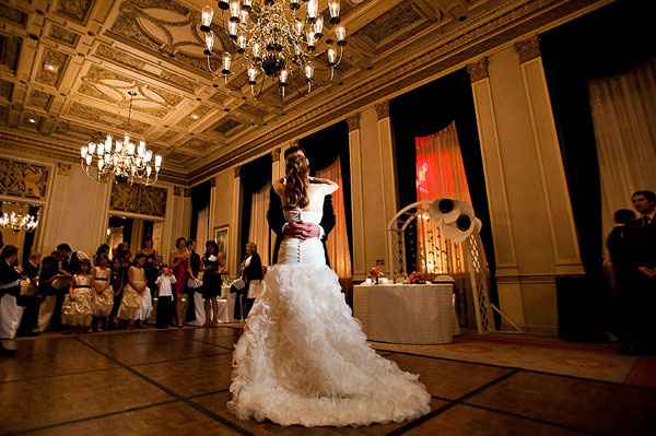 bride and groom first dance in grand ballroom
