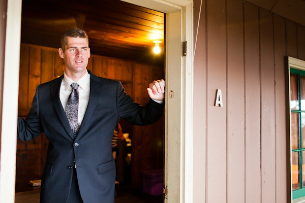 groom in cabin doorway