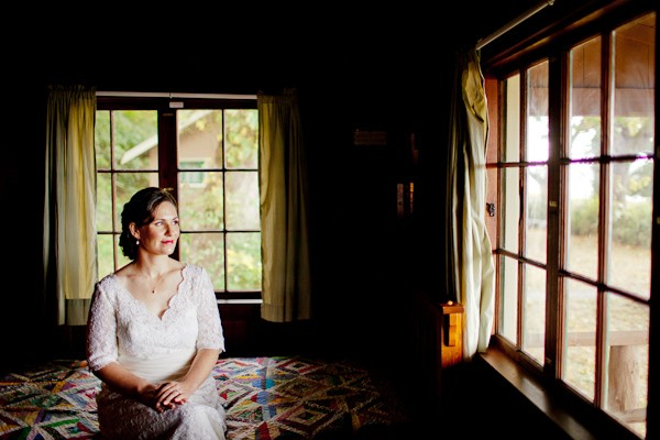 bride sitting on cabin bed