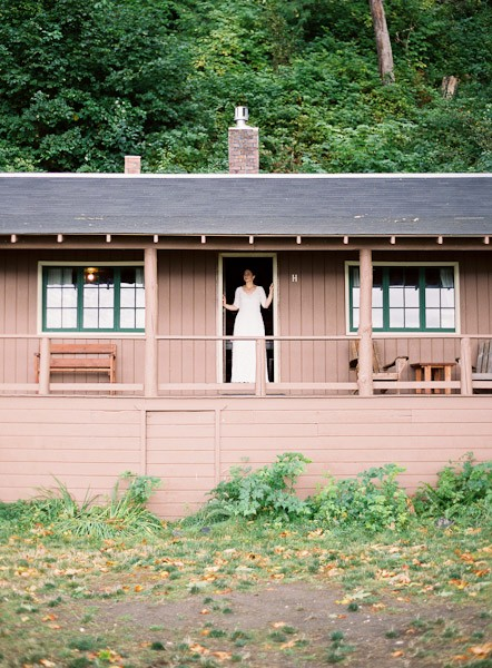bride on cabin porch