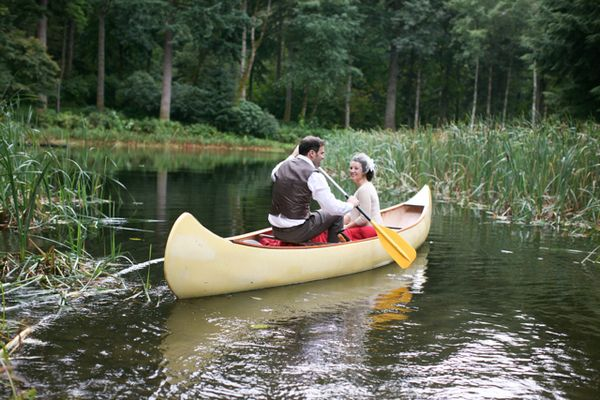 bride and groom in a canoe