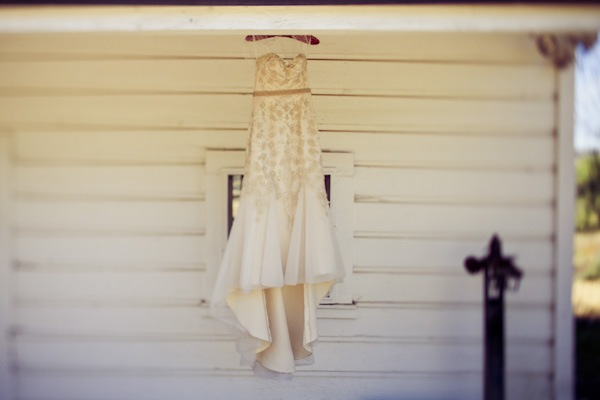 wedding dress hanging up on the porch