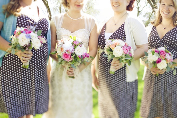 bride with bridesmaids wearing polka dot dresses