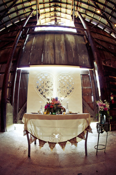 sweetheart table set up in barn