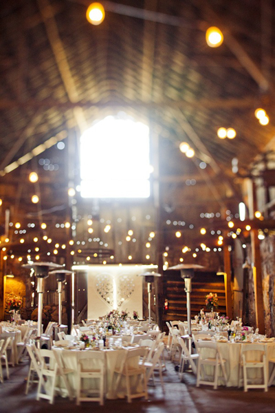 barn wedding reception lit with twinkle lights