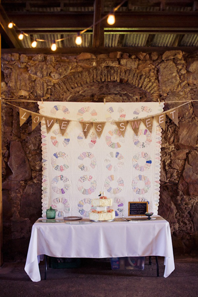sweet table with quilt backdrop and burlap bunting