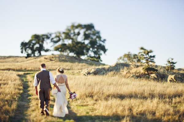 bride and groom walking on the ranch