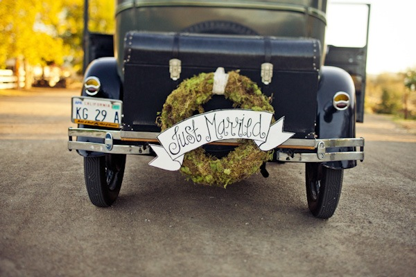 just married banner on vintage getaway car