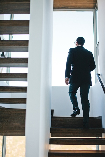 groom climbing stairs