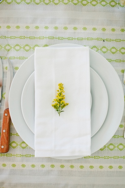 place setting with yellow flowers