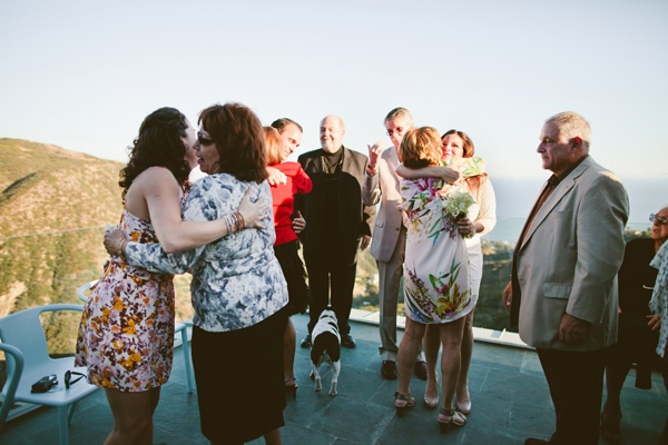 guests on balcony wedding
