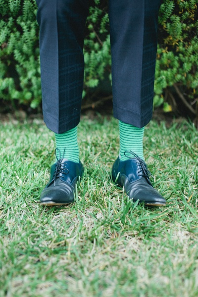 groom in green striped socks