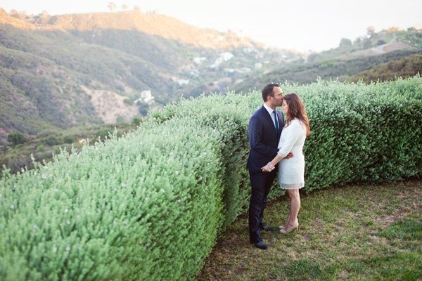 bride and groom kissing in Malibu hills