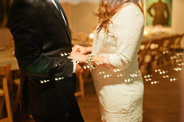 bride and groom holding hands at reception