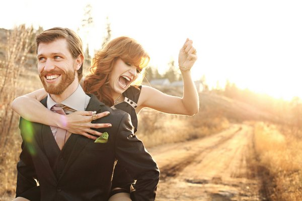 playful bride and groom portrait