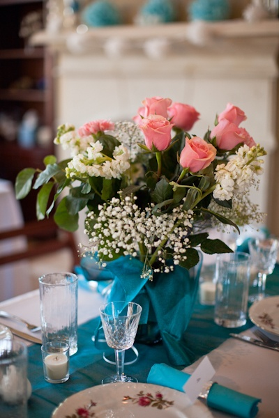 pink rose and baby's breath centerpiece