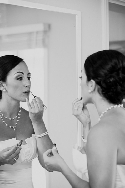bride applying lipstick