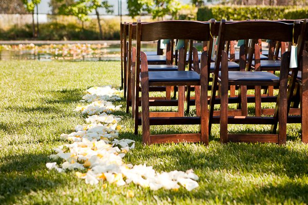 white and yellow rose petal lined wedding aisle