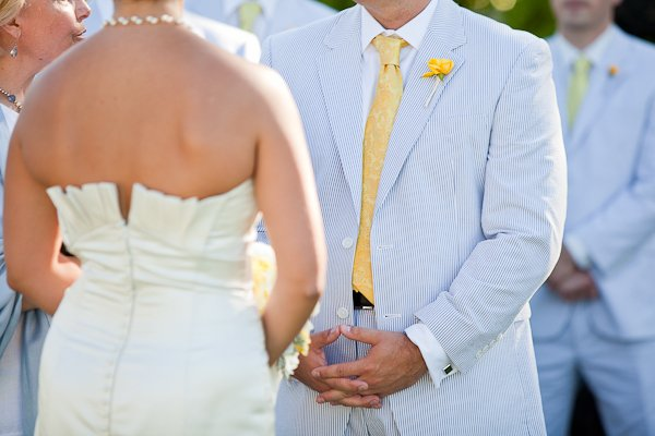 groom in seersucker suit and yellow tie