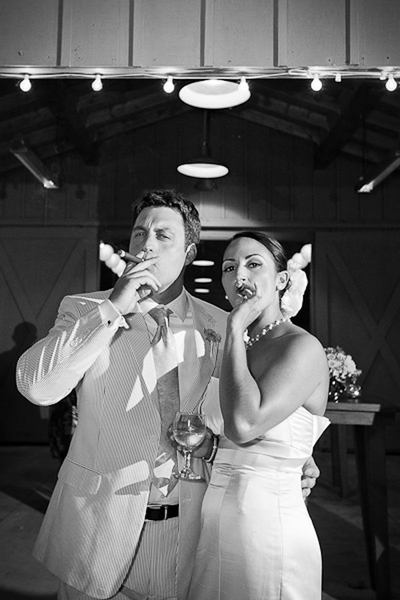 bride and groom smoking cigars