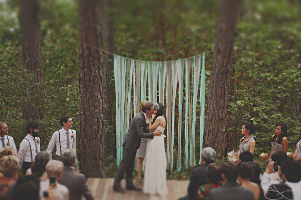 Wedding arch ideas this simple backdrop gives a surfing themed wedding the extra boost that it needs having a surf board on each side leads the eye to the bride and groom junglespirit Choice Image