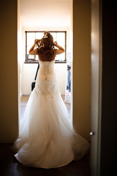 bride in corset back wedding dress