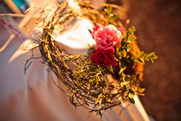 twig wreath with two pink roses