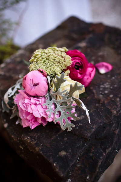 peony, ranunculus, and dusty miller wedding arrangement