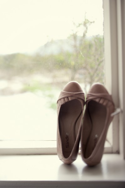 bride's shoes in window