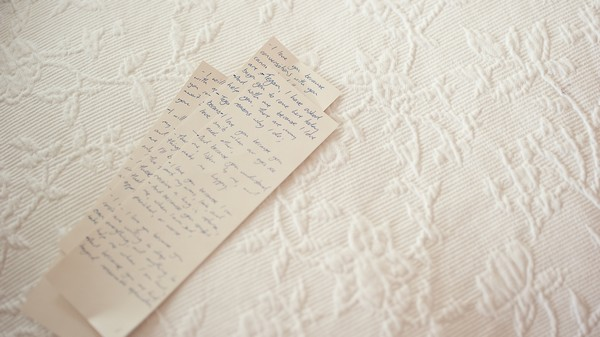 handwritten wedding vows on bedspread