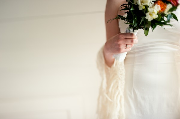 bride in strapless dress and wool shawl