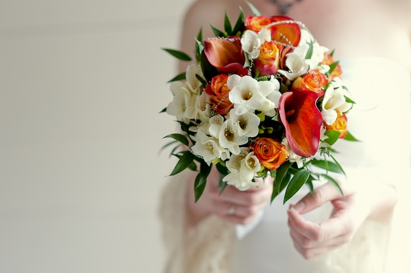 white and orange wedding bouquet