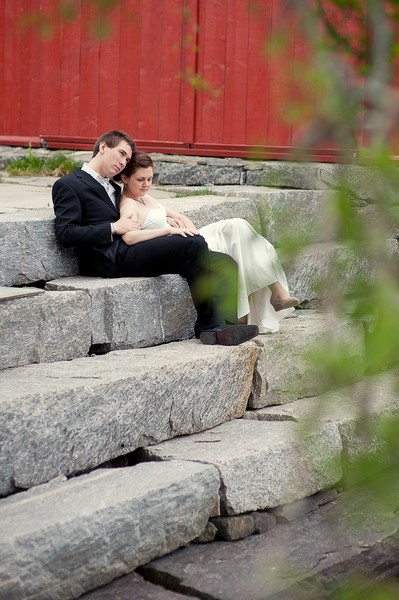 bride and groom sitting on stone steps