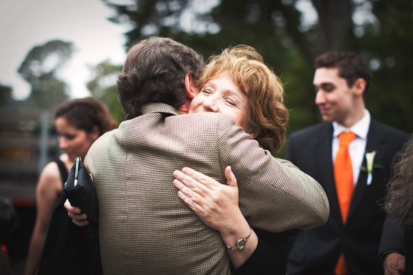guests hugging at wedding