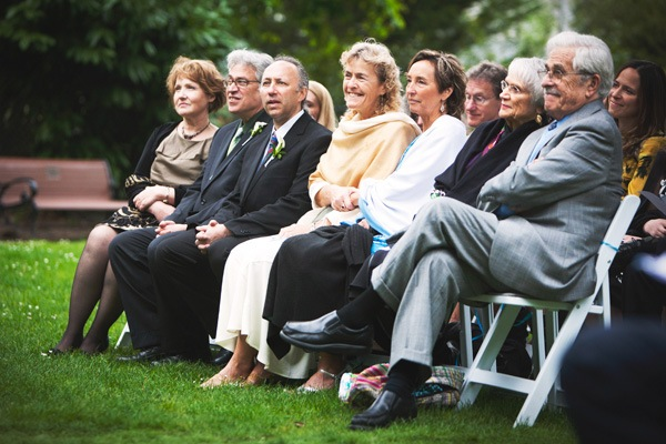 wedding guests at park ceremony