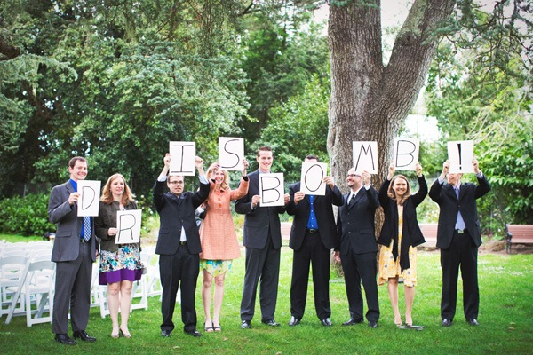 Wedding Guests Holding Up Sign