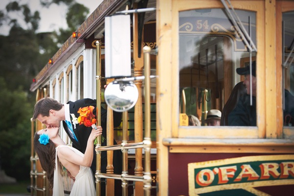 bride and groom and kissing on trolley