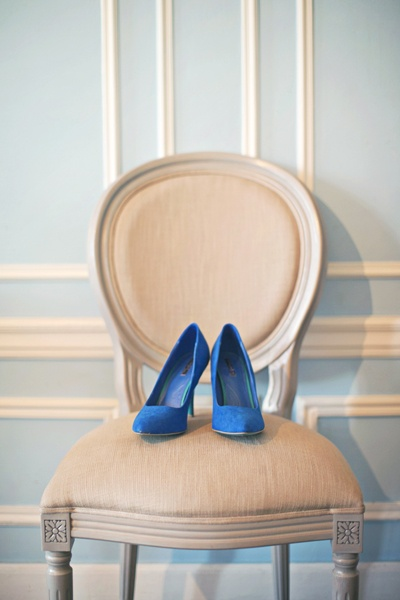 blue suede wedding shoes on chair