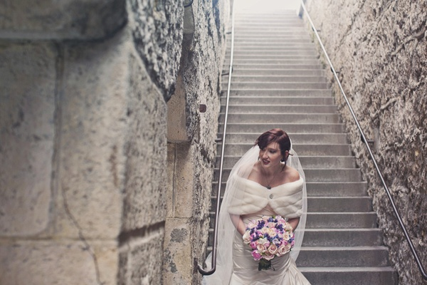 bride at bottom of stone stairway