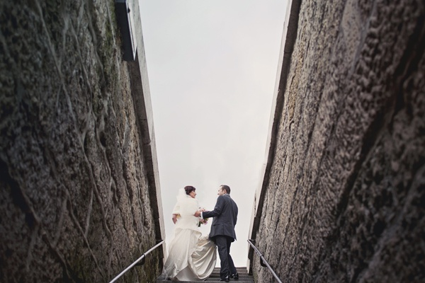 bride and groom climbing stairs