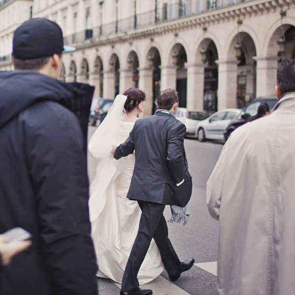bride and groom crossing the street in Paris