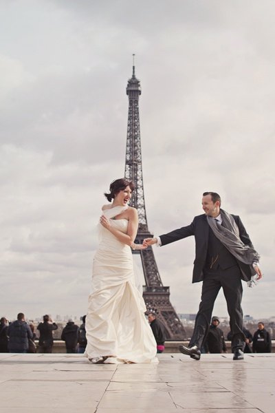 bride and groom dancing in front of Eiffel Tower