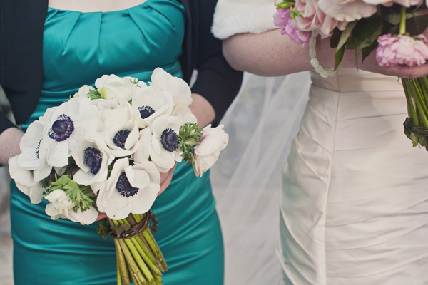 bridesmaid with white anemone bouquet