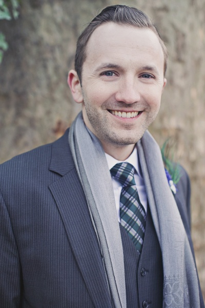 groom in pinstripe suit and plaid tie