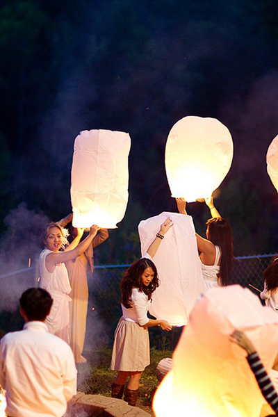 wedding guests releasing sky lanterns